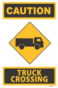 caution trucks crossing